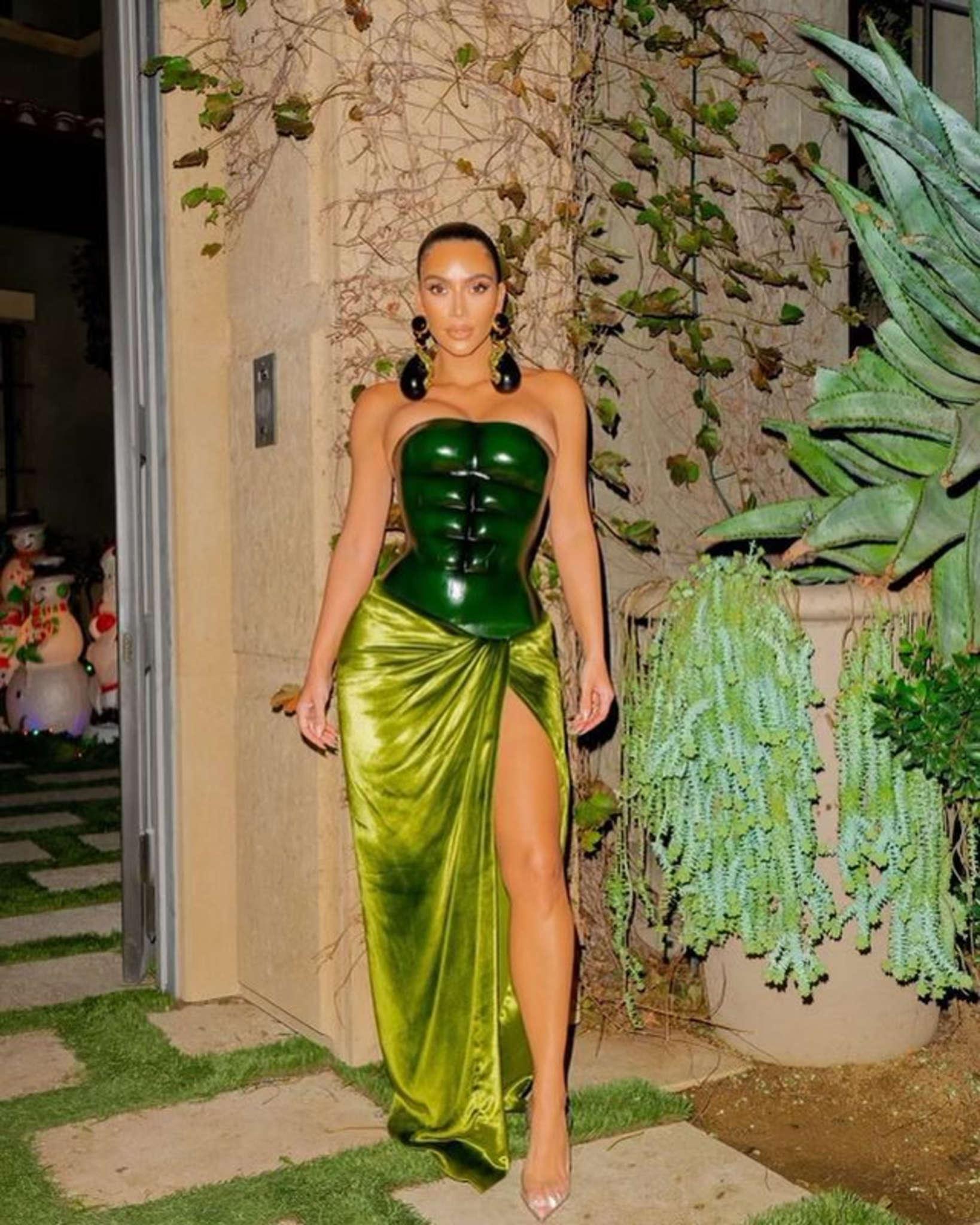 1609010270 849 Kim Kardashian Wore Custom Schiaparelli Serpent Gown With Snake Earrings