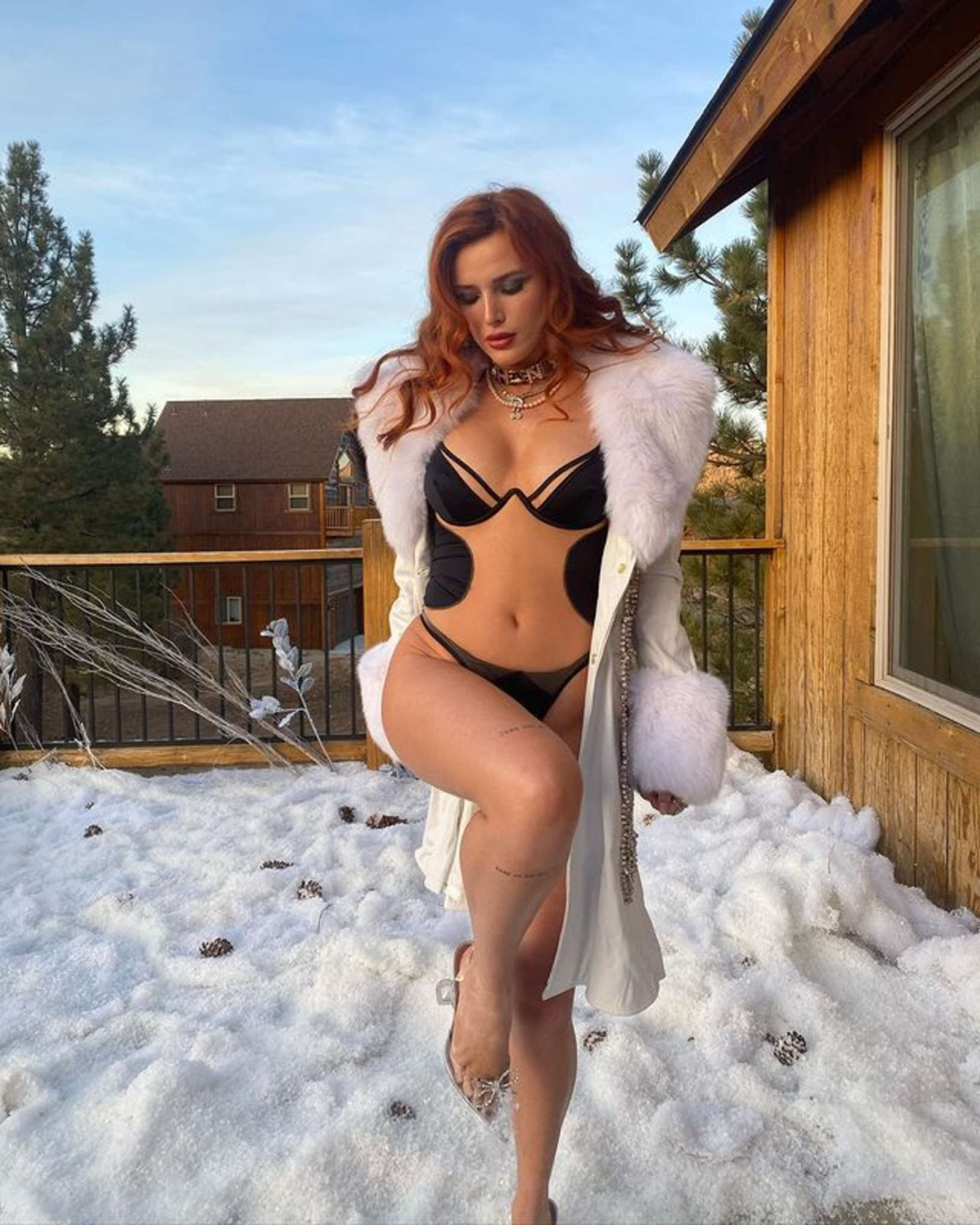1609086075 170 Bella Thorne Wears Lingerie While Outside In The Snow