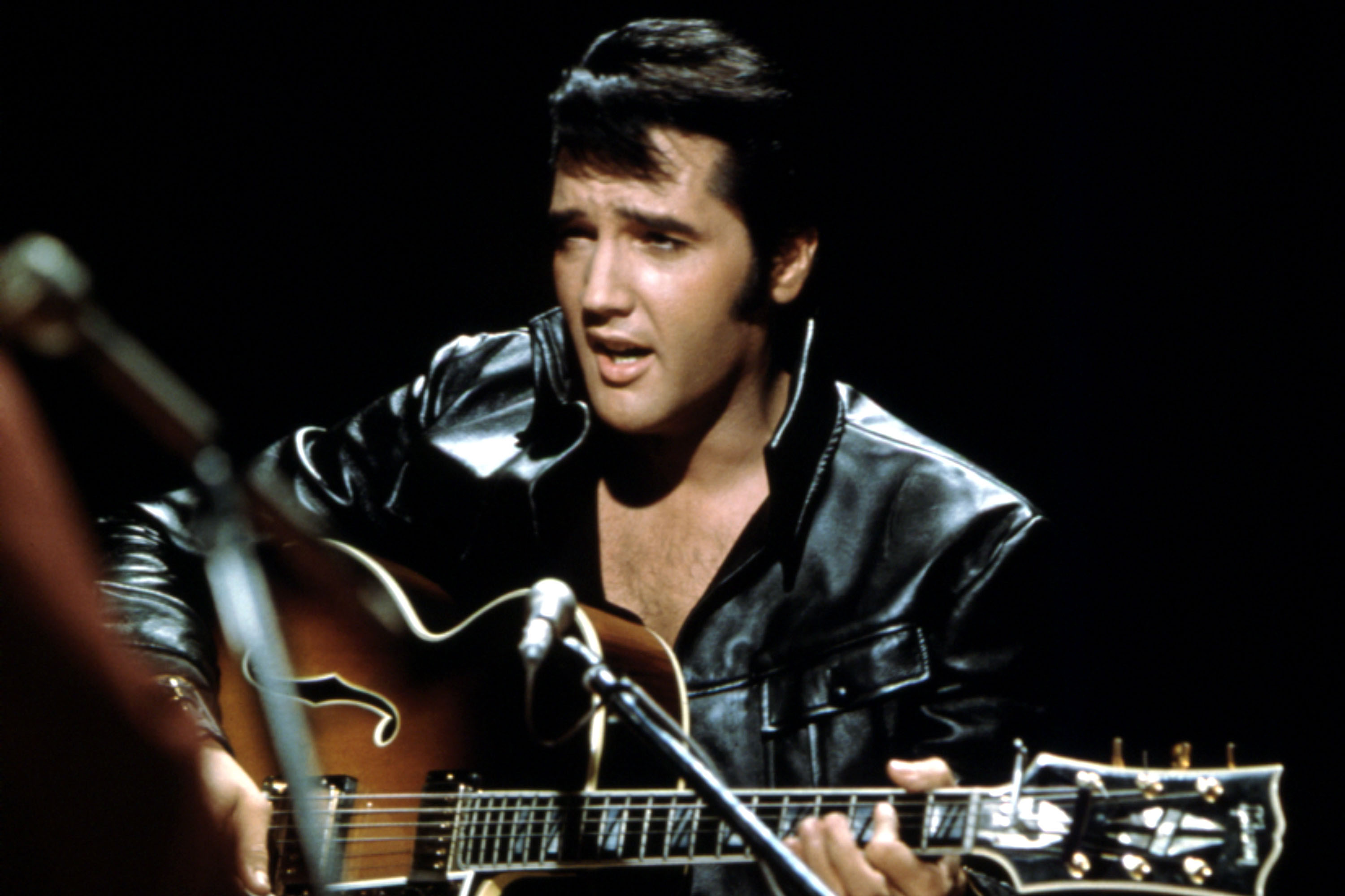 Elvis lives again — in songs sales and birthday bash