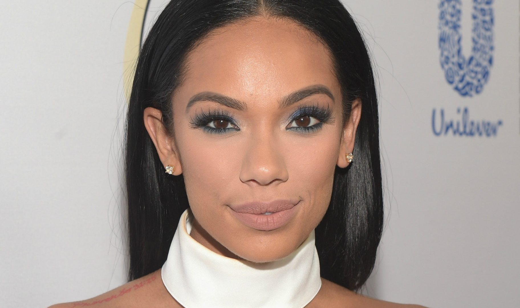 Erica Mena Is Shining In A Golden Dress For Christmas
