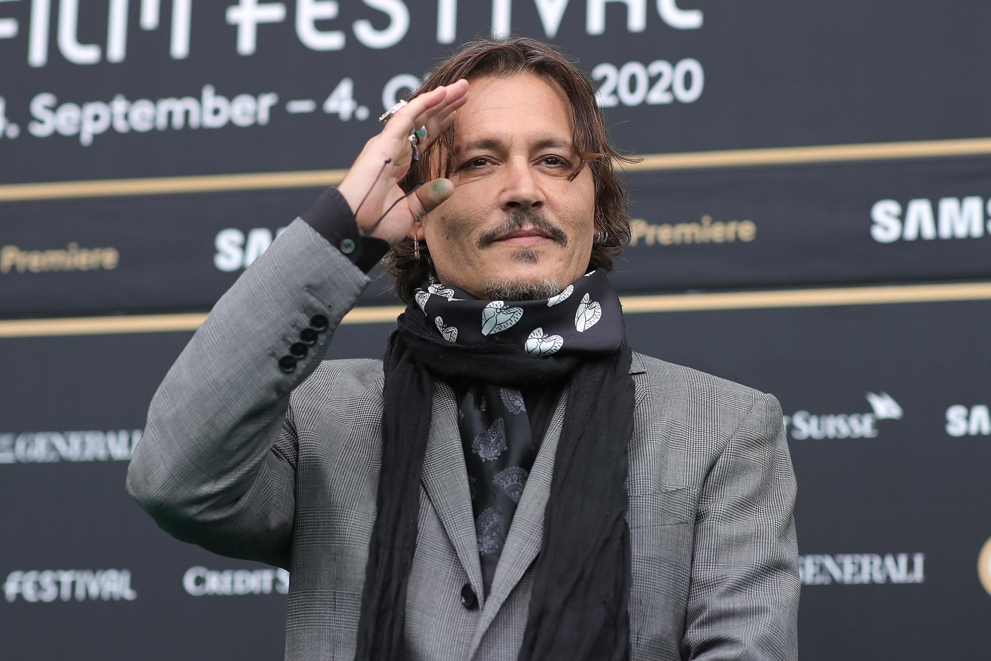 Johnny Depp tells fans he hopes for better times in