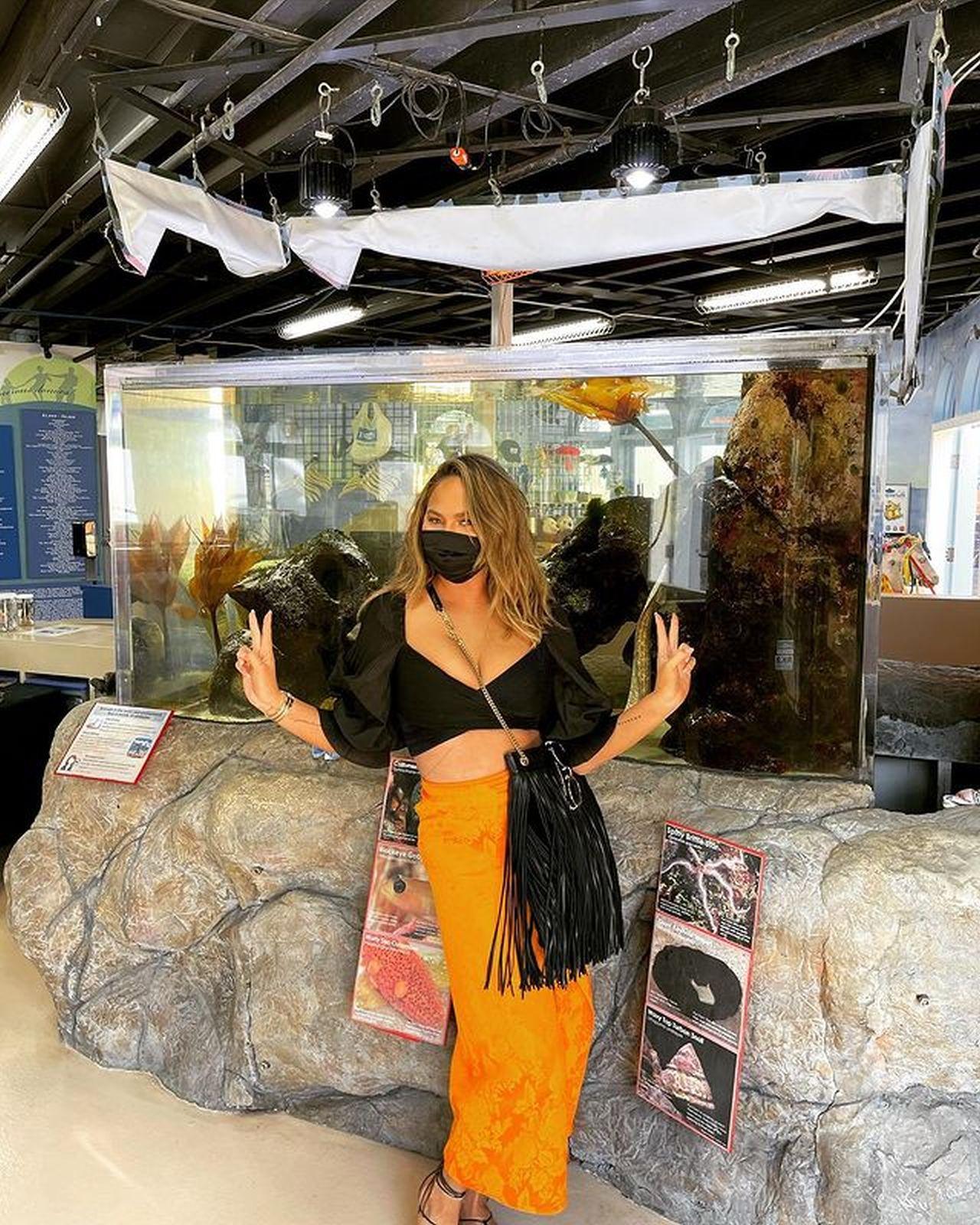 Chrissy Teigen Stuns In A Wrap Skirt And Crop Top